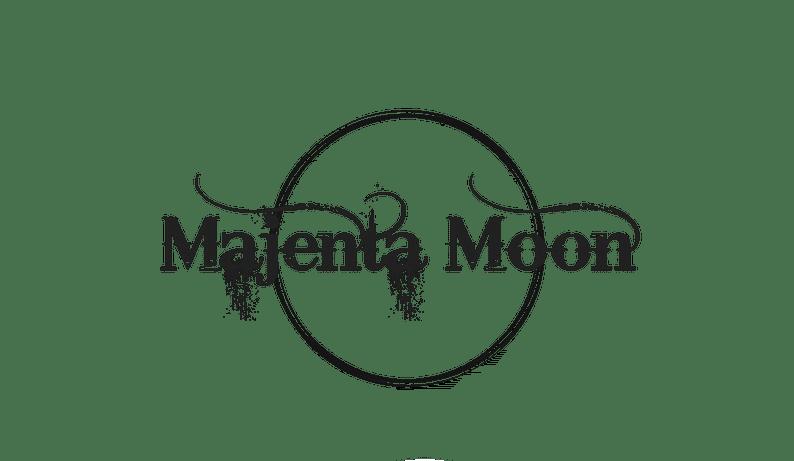 Majenta Moon written in scrawly font inside a moon outline