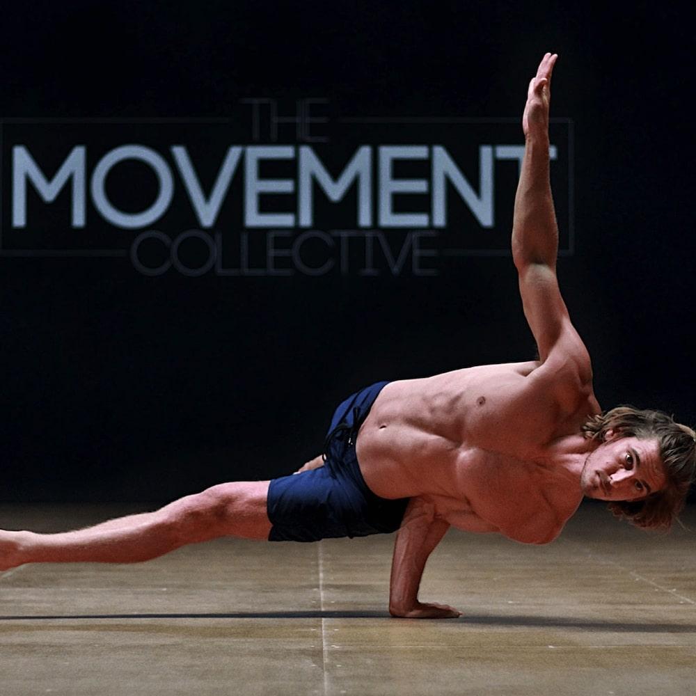 rod cooper man doing gymnastics handstand on a single arm