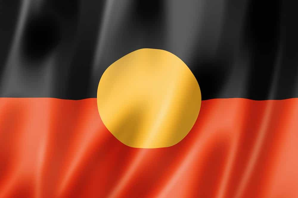 Aboriginal Flag - black line and red line meeting in the middle with a yellow circle